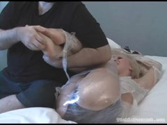 Sweetheart bound in plastic wrap giggles whilst tickled