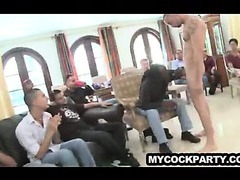 Male stripper getting sucked off by a group