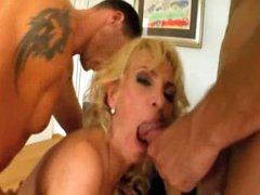 Blonde milf gives up her holes in foursome