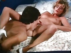 Young horny couple in a classic porn episode