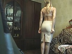 This blonde fem was late so that chick didn't have time to look around or even think that there could be a voyeur with the cam in her room when that chick put on her white lacy bra and beige petticoat