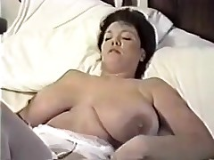 This homemade movie is a mix of sexy movie scenes I have taken of my huge-titted wife. U can watch her strip, give me blowjob, shave her cunt, masturbate during the time that I fuck her, play with sex toys and take a bath.