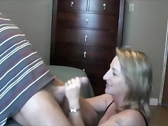 This lady loves to handle and engulf her husband's cock.  This babe sucks it, puts on some flavored lube, and the strokes the shaft while this babe tonguing the tip in her mouth.  That guy lastly cums in her mouth, moaning, and this babe swallows, with just a little bit of the cum dribbling out.