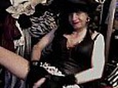 This eccentric dark-haired woman masturbates wearing an odd costume, she even wears a hat. This is one of the nearly any original homemade clips though.