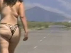 Out in the open desert walking in the midst of a highway with only a g-string covering her large wazoo body. In this public sex episode u can watch this mature bitch walk naked out in the open and flaunt her large fucking ass.