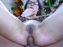 Upskirt chick in glasses receives her curvy behind licked and dicked by a guy