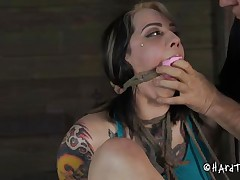 Being a naughty cunt and taking off her pants way to often Angel acquires an humiliating castigation that she will hardly forget. The executor takes her pants off and stuffs her mouth with them! He then uses duct tape over her mouth and gapes that agreeable shaved cunt. Now that guy tied her on the chair, curious why?