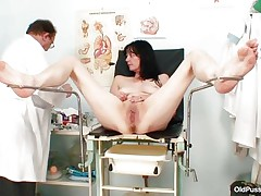 Mature brunette hair babes with nice body and wicked pointer sisters is sitting the gynecologist table absolutely undressed with her legs spread so that her doctor can exam the wet crack between them. He recommends her a dildo therapy so the treatment begins as he introduces that sex toy unfathomable in her bald vagina. This babe becomes horny and does treats her pussy with her own hands.