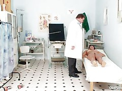 Naked Mature lady with big tits visits the doctor for her pussy examination. That honey is ordered to lay on the patient's couch doctor examines her stomach and then wears his gloves and tells her to widen her legs so that her cunt can be tested. Doctor examines it and then checks her wazoo and ask her if that honey had anal sex ever that honey replied with no.