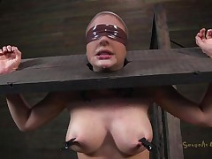 Clamps with weights were attached on her large boobs and duct tape was used to blindfold her. Now that babe stays there in that thraldom device and has a rodeo sex machine underneath her that's rubbing her shaved pussy. To make things interesting an executor comes and deeply mouth bonks this slut girl, chocking her with pecker