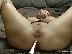 Bound on the sofa and ball gagged this doxy gets some shocks with an electric wand. The executor pays particular attention to her nipps and wazoo hole. Now it's time for some hard whipping on those hawt thighs and wet pussy. It looks like she's ready for a hard fuck but still needs some spanking on that cunt