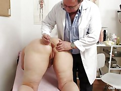 Yvonne is at gynecologist completely naked and waits for the doctor to examine her body. She's a bit bulky but that means there's a lot more to love as the doctor carefully and gently inserts a medical tool in her hot bald darksome hole and then this chab gapes her bald vagina looking inside her pink pussy, that cunt is perfect for a hard dick and maybe the doc will give her some fucking therapy.