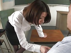 I stayed after hours to have a chat with me teacher Kaoru, damn she's a fine piece of ass and all the boys in the class want to nail her. Luckily Kaoru was insanely lewd that time and this babe knelt in front of me, took out my cock and started to suck it and the balls too. I filmed her and boy I'm proud of that!