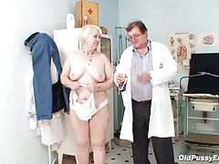 Bozena is a older lady with large boobs, lustful face and large ass. After doctor asks her to strip this guy is using a engulfing machine to make her nipples harder. This doc has a filthy mind and surely this guy is making her horny, who knows what tricks this guy has to make this old whore willing to fuck.