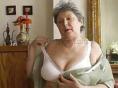 Granny takes off her shirt and bra and her heart rate increases as this babe begins massaging those large saggy boobs. Just like in her youth this fucking whore takes off her clothes to pleasure men! Granny removes those white panties and reveals her saggy hairy cunt that she's enjoys rubbing. What she's up to next?