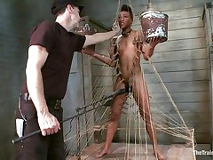 Nikki is all tied up and standing on her legs. Filled with clothespins and strings, she has to be careful and not to drop the two buckets she`s holding, while a big vibrator makes sensations on her moist cunt. This babe receives all whipped for being such a bad ebon girl. Her executor will take very priceless care of her!