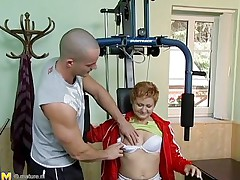 Watch this hawt red headed cougar who takes advantage of this juvenile gym instructor. She has great sex experience and begins seducing him, like she well knows. This old honey has all she needs to make a dude happy. She begins taking off her raiment to turn the juvenile stud on. He loves playing with her tits.