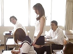 Manami Suzuki can't live without teaching. Someone's out to expose her for the bitch that chick really is, hitting the remote control of her vibrator, causing her to moan as that chick walks throughout the class. A student's father comes in, his son saying the teacher's a porn star. Pretty soon she's nude in front of the class.