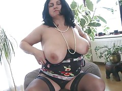 This chubby older is going eager and definitely in need of some masturbation. So with out wasting any time she is revealing her huge boobs and crushing 'em to make her pussy wet. After she is rubbing her pussy and fingering it. As soon as is becomes wet she is licking her love juice through her hands.