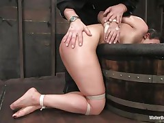 The old, experienced executor is showing this youthful hotty what this guy is capable of. That guy bound her hands and legs and grabbed her by the neck so this guy could put her head below water. That hottie is wet and dominated and looks like this slut enjoys her situation a lot, especially when this guy slaps her ass and uses a sex tool to stimulate her clit.