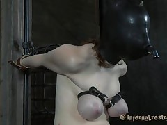 Pale and with a fragile body, this dark brown is the subject of an hardcore sadomasochism session. She's masked and her breathing rationalized, her boobs are squeezed hard and that tight pussy between her long legs is screwed deeply. Her name is Dixon and she reached the human endurance limits, or did she?