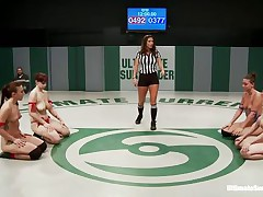 `Four horny lesbos are wrestling in 2 teams, blue and red. And these chicks are fighting naked, showing their nice boobs and asses as well as their pussies! Watch them grapple every other and tit groping with fingering; these count as points. And finally the winners will have the chance of fucking the losers!`