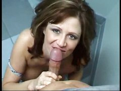 This babe goes into bathroom to engulf cock