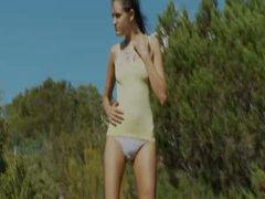 Extra skinny girl make striptease outsite